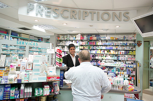 pharmacy white male asian pharmacist