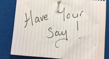 pinned post-it saying 'have your say'